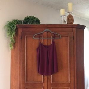 Maroon Tank with strappy details on back.